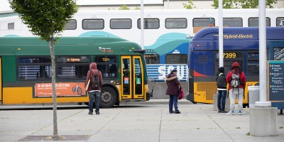 Customers board buses in Kent
