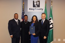 Councilmember Larry Gossett, Debra Baker, graduate Kamilah Brown, KCC, and King County Executive Dow Constantine.