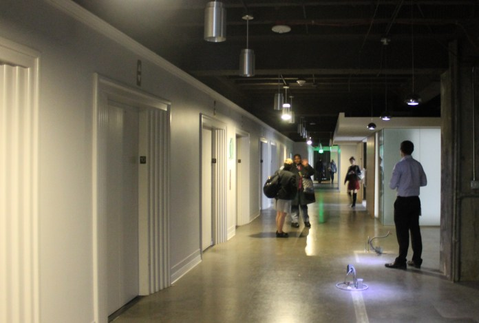 DPD employees tour the Dexter Horton Building in advance of their move to the new location.