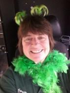 Bus operator Kathy Maddux in festive St. Patrick's Day gear.