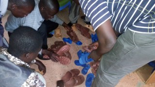 Pastor Moses and the team making sure that the sizes of sandals are ok