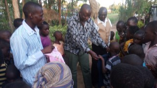 Pastor Moses giving clothes to orphans 1