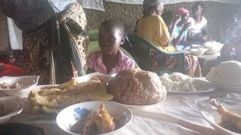 chiken, rice, brown ugali chapati and white Ugali