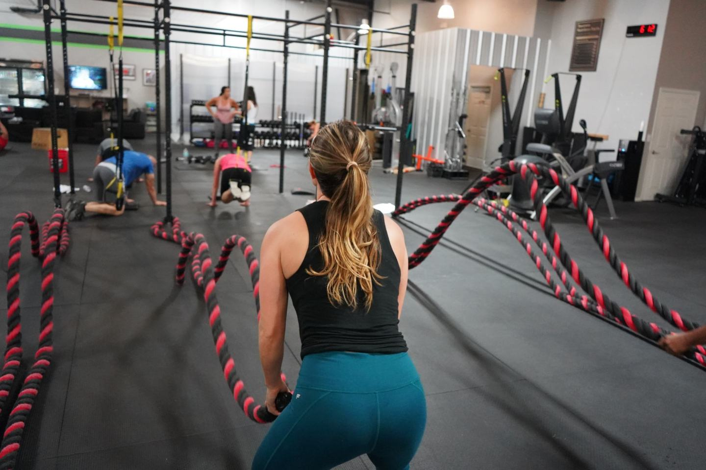 photo of a woman exercising as a good habit for switching up your life
