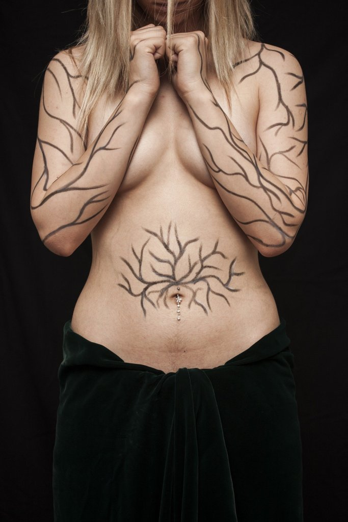 Body of a tattooed woman depicting body shaming