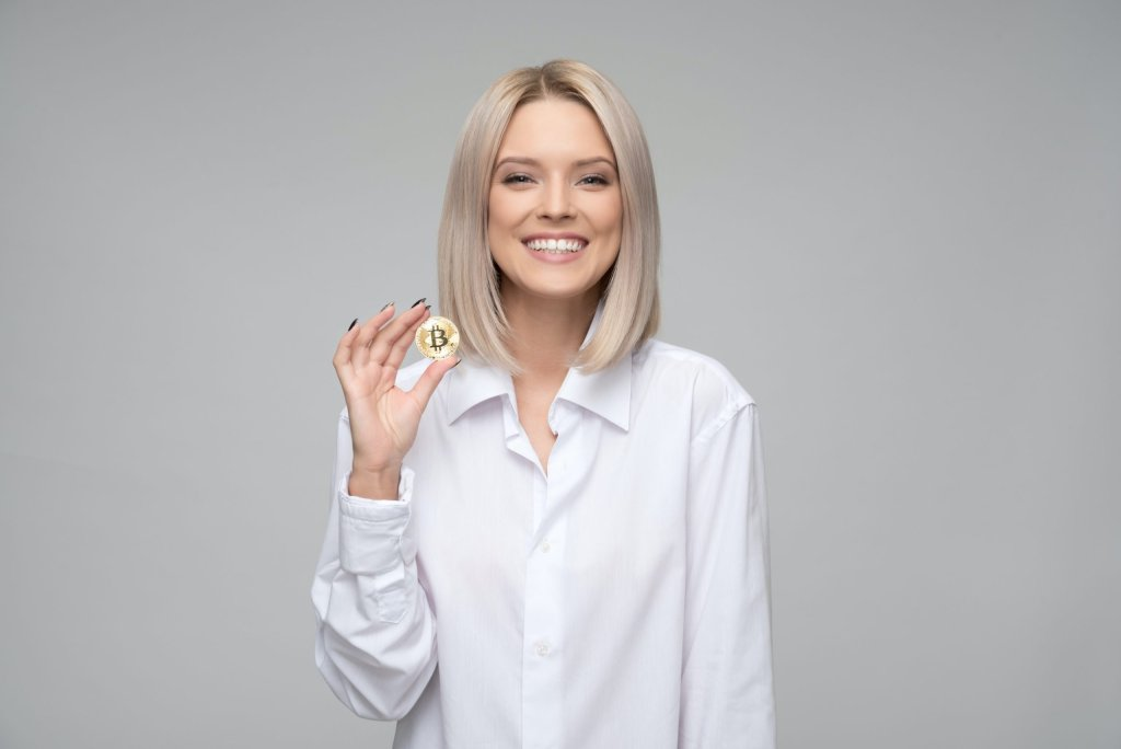 Smiling woman holding a coin