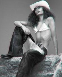Cowboy hat - stylist's own | Bra - Maison The Faux | Belt - Vintage Fiorucci | Leather Chaps - First Mfg Co. | Jeans - Levi's | Cowboy boots - Sendra