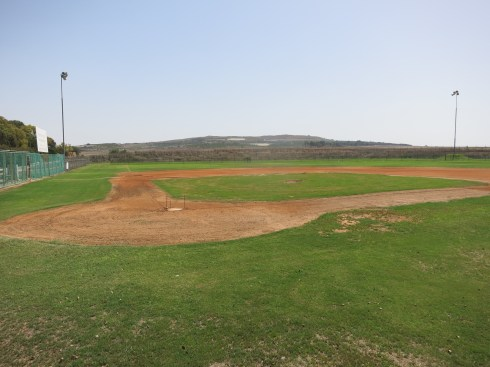 The field at Kibbutz Gezer.  Behind the left field fence are remains of King Solomon's Temple.