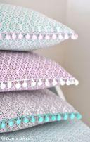 Image via - http://toriejayne.com/tutorial/pom-pom-trim-boudoir-cushion