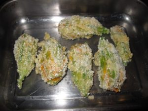 Squash blossoms stuffed and ready to bake