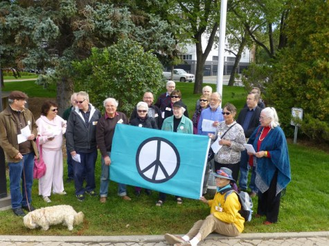 Regina residents and city staff raise the Peace Flag at City Hall prior to the UN International Day of Peace.
