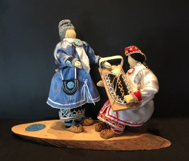 Elizabeth Doxtater, Where the Water Never Freezes, 2012, cornhusk dolls, fabric, leather, beads, wood. Collection of the Artist.