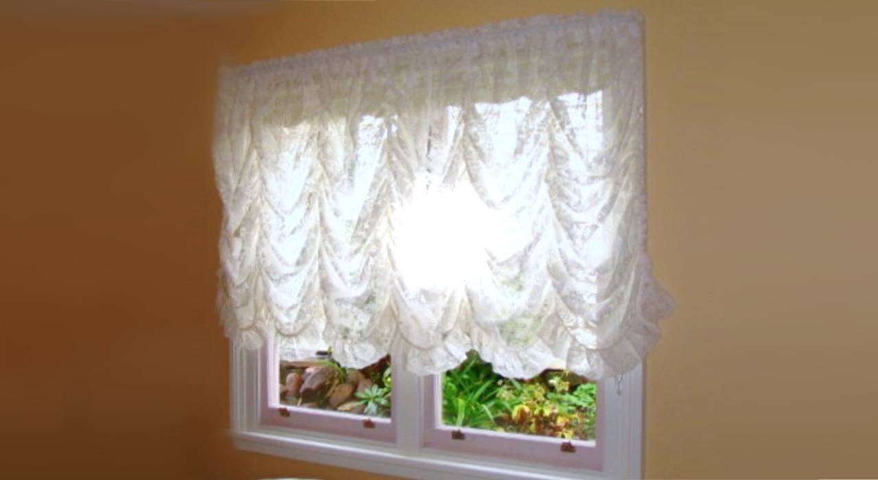 lace-festoon curtain at window