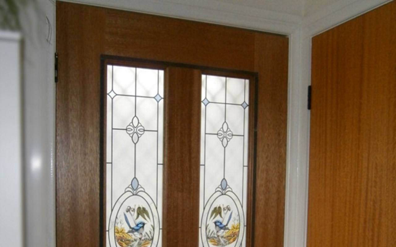 Door with secondary glazing