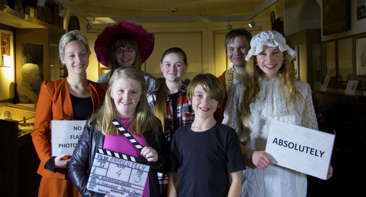 Absolutey cast with clapperboard production shot.