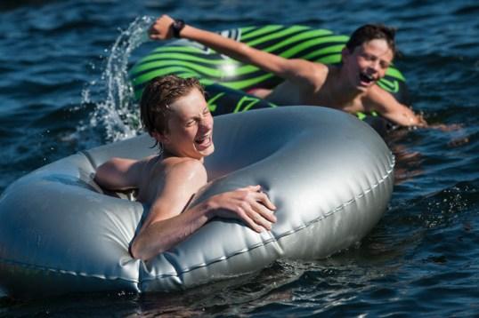 boys having fun in tubes