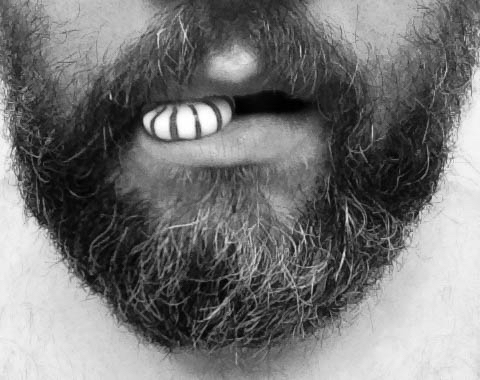 Man with beard and candy in his mouth