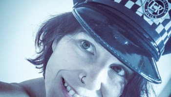 Molly wearing Police Hat for Kink of the week topic of Uniforms