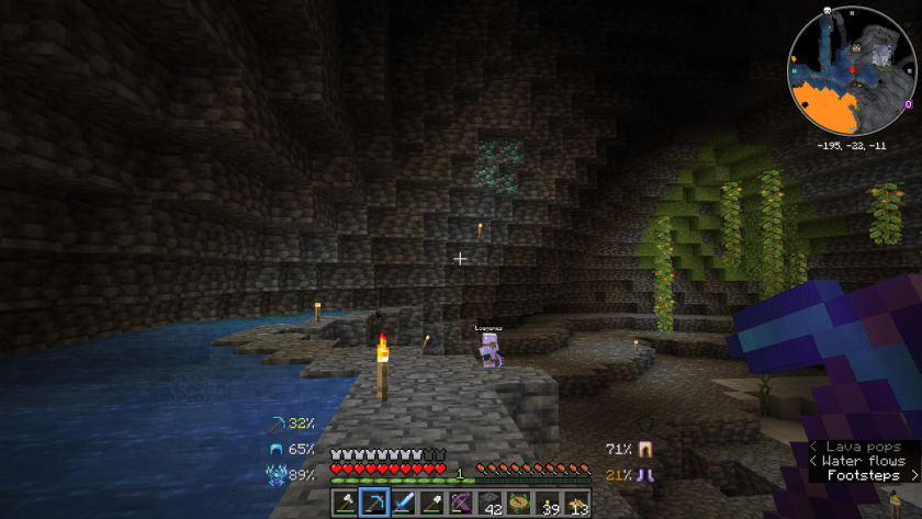 Loa standing below a cave wall covered in a few blocks of diamonds