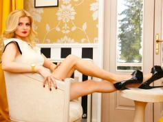Stunning blonde Dominatrix DominantMiss @CamContacts subdues slaves with sexy legs and heels