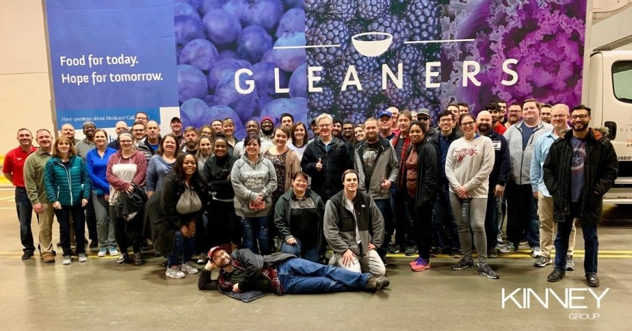 A group of engaged Kinney Group employees volunteering at Gleaners Food Bank.