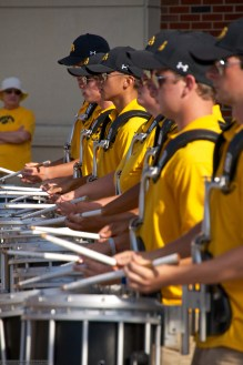 HMB Drum line warms up the tailgating crowd outside the Kinnick entrance