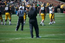 Coach Ferentz observes front the field.