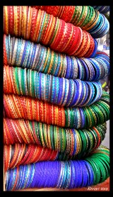I love the way all these colourful bangles unite to make something look so beautiful.