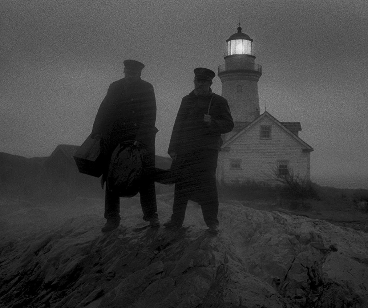Two men standing in front of the Lighthouse
