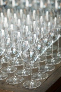 Wine glasses for event, event details, event photography, black cherry photo event photographer, confrence set photographer,