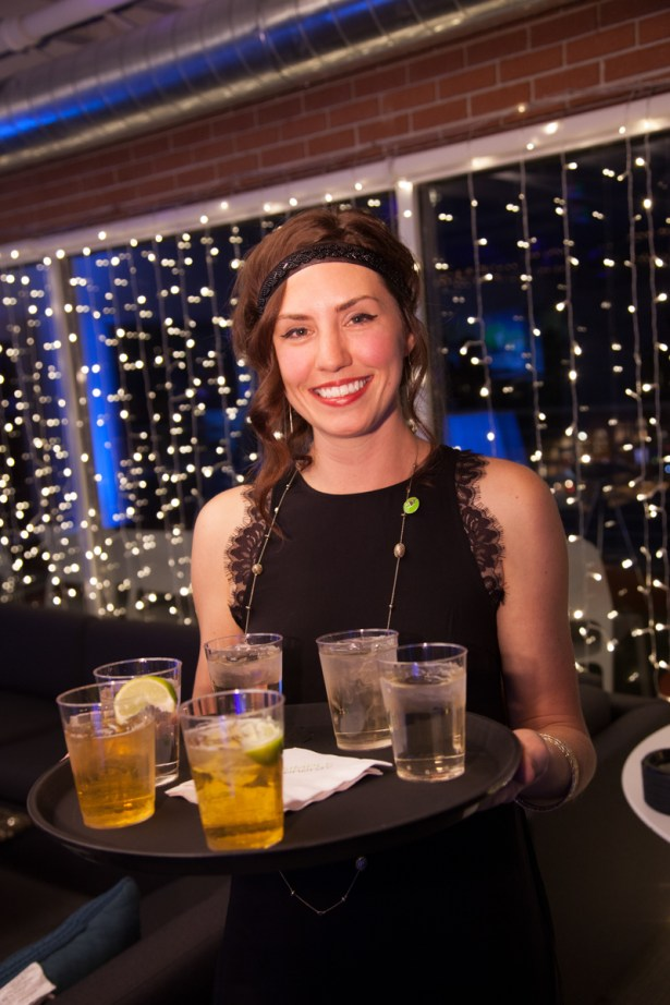 cocktails at holiday party, happy server at holiday party, cocktail waitress at corporate holiday party