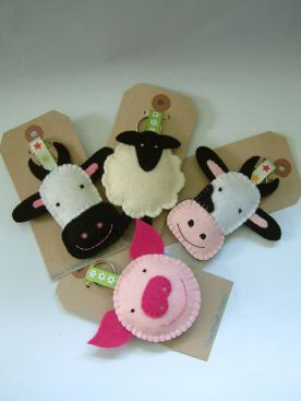 http://www.etsy.com/listing/104507943/farmyard-keyrings-cow-sheep-or-pig-felt?ref=sr_gallery_42&ga_search_query=Cow&ga_order=most_relevant&ga_view_type=gallery&ga_ship_to=US&ga_page=10&ga_search_type=handmade&ga_facet=handmadeCow