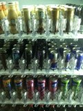 A vending machine full of iced coffees and energy drinks.