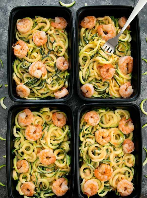 overhead photo of Skinny Bang Bang Zucchini Noodles in meal prep containers