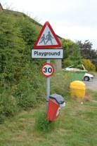 Playground sign, 30mph sign dog litter bin and grit bin on Habton Rd