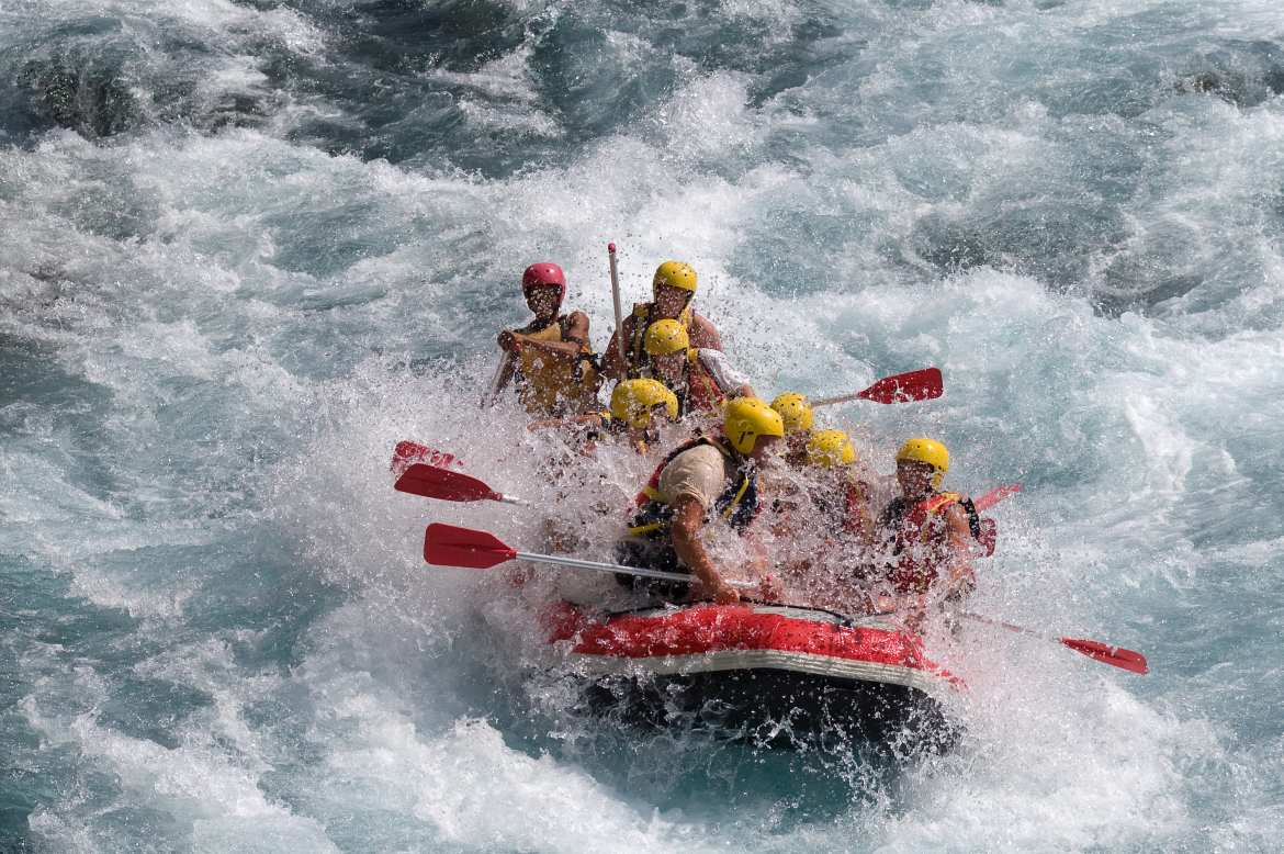 large rafting team navigating white water rapids as a representation of how early-stage and late-stage funding differ