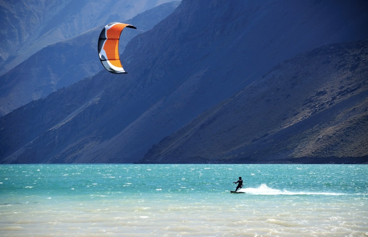 Kitesurfer on a lake in the Andes Mountains, Chile