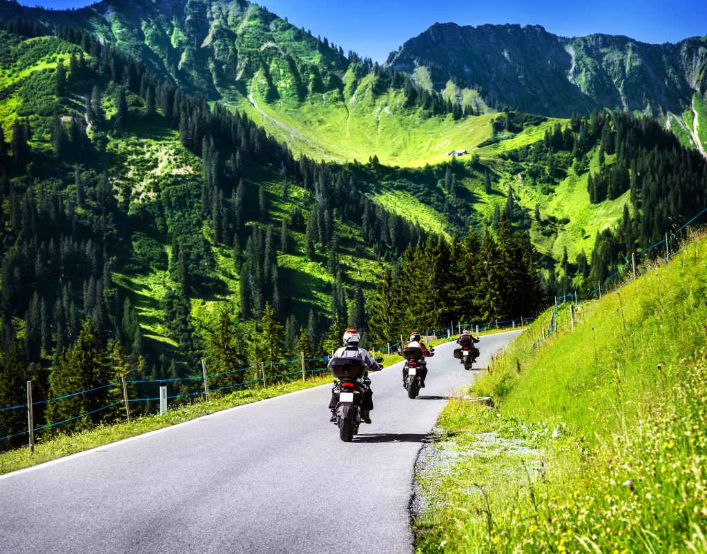 Group of bikers on a clear clean highway