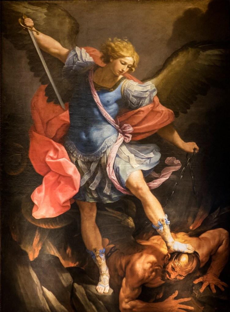 Kuvassa on maalaus, jossa arkkienkeli Mikael polkee maahan paholaista ja osoittaa häntä miekalla.