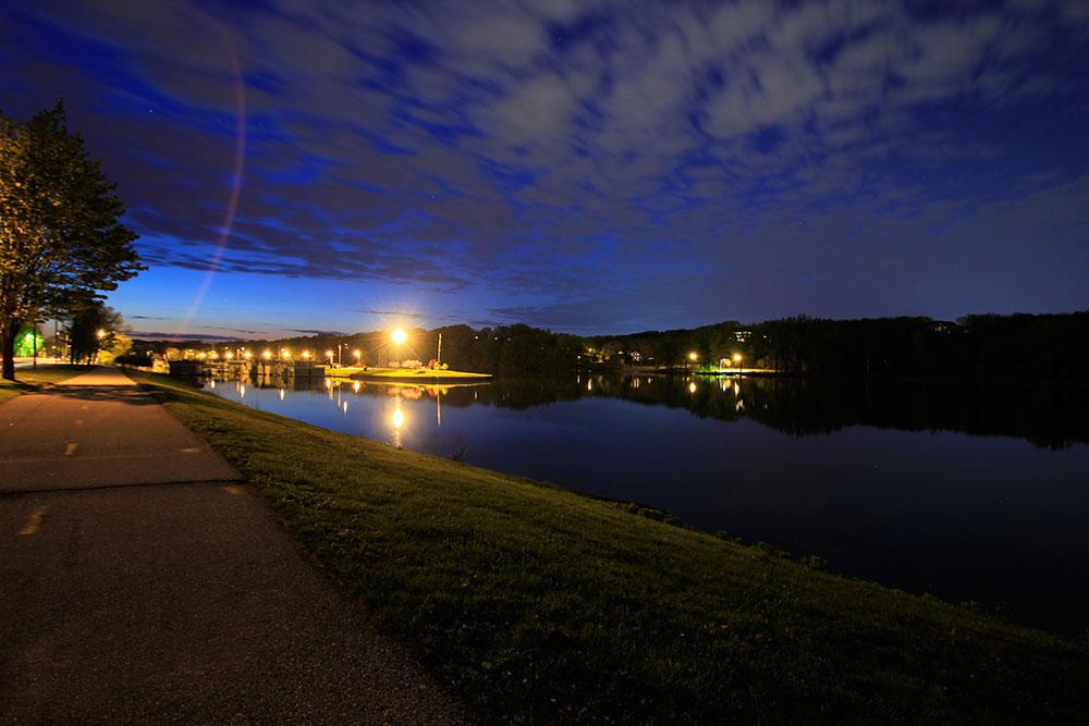Ellis Harbor on the Cedar River at night in Cedar Rapids by Kirk Taylor