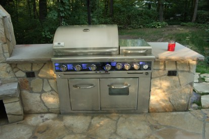 2-BBQ center in stone island-grill-oven-side burnerstorage cabinet-electrical outlets