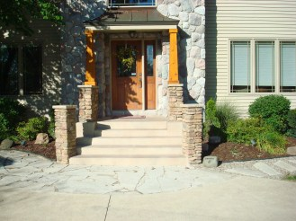 3-monroe michigan-exterior entry-stone posts-porch-steps-wall-cedar posts
