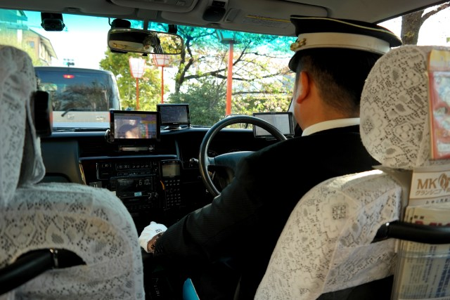 Stylish taxi driving - white gloves, cap and lace by Kirsten Bukager