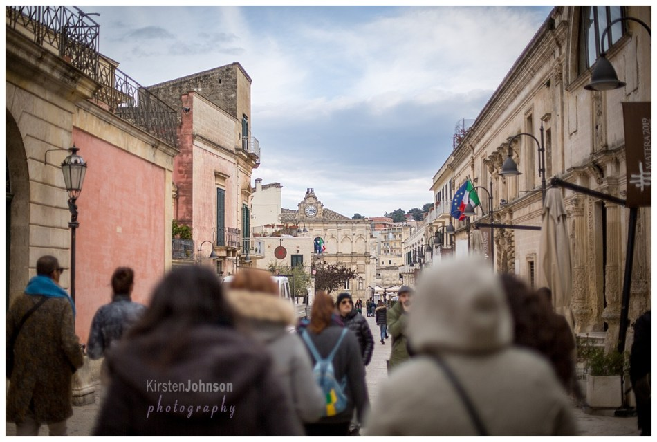 Street in Matera, Italy with people in the foreground and buildings going into the background