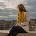 woman sat on a wall looking out over Matera, Italy