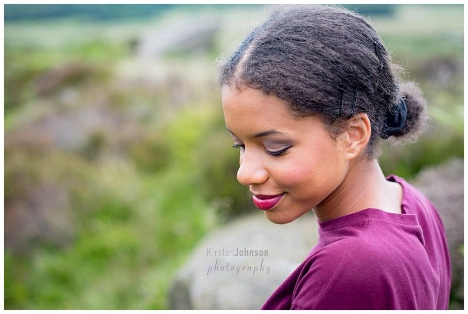 Teenage girl looking down over left shoulder