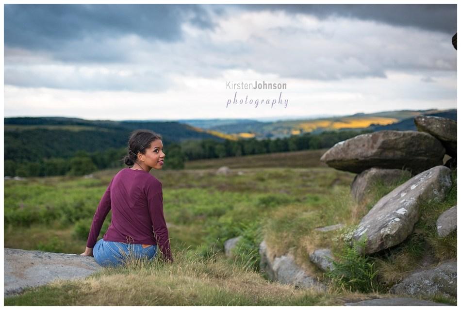 Teenage girl looking over peaks
