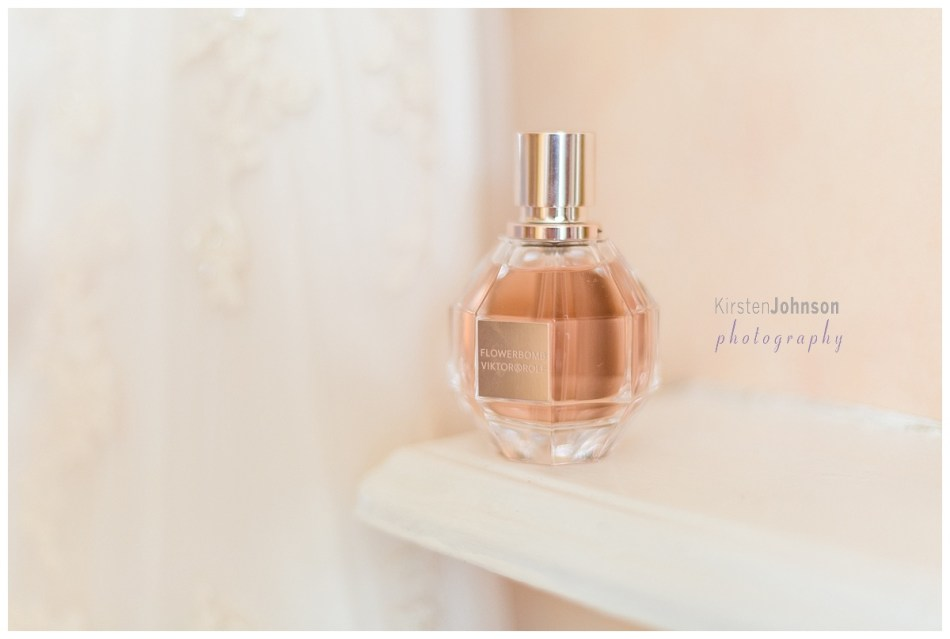 bottle of perfume by brides dress