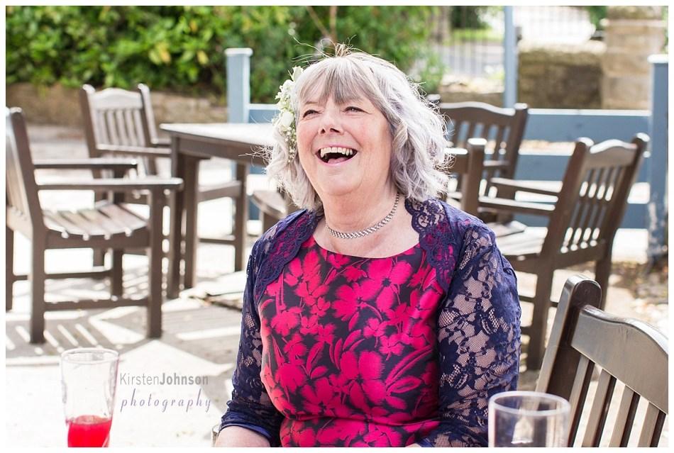 mum of groom laughing