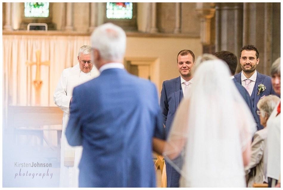 groom sees bride coming down aisle
